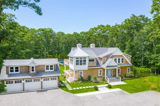 This new and impressive home is a clear value in the middle of Watermill's horse and Farm 'Country'. Built to entertain, this large home has all the extras you would want. As you pull in the paved open driveway you instantly notice the unique style and separate three car garage. Once inside the home its traditional lines invite you to a top of the line kitchen, dining space, and cozy den. Also off this space is a slate radiant heated floor in a beautiful study.