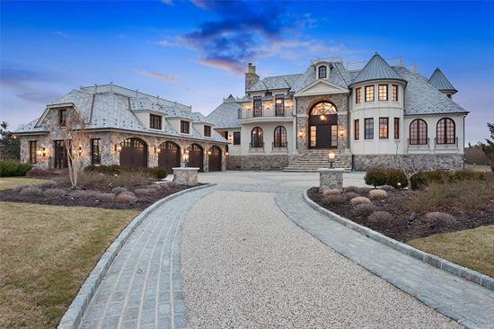 Elegant Hamptons Oceanfront Estate. Featuring an open floor plan. Imported exotic marble and stone. 7 Fireplaces. Infinity edge pool with ocean view. Indoor golf simulator. Endless lap pool. Two kitchens. Five bedrooms. Detached four car garage. This home boasts one of the best ocean views in Quogue.