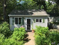 Paradise awaits in the picturesque hamlet of Baiting Hollow. This one of a kind, turn-key, well-maintained home in a family oriented summer beach-front community. All cash sale includes all furniture & home goods Home boasts multi gardens, parking for 4+ cars, 3 bdrm, 1.5 baths, formal dining, kit, living rm, in-home W & D, deck & patio, whole house fan.Minutes from all the North Fork has to offer golfing, boating, fishing, restaurants, aquarium, waterpark, wineries & outlets.Lot rent $6, 402.90