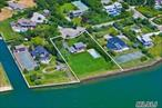 Waterviews Don't Get Any Better Than This!! 1 Acre on Open Bay Front. The property currently has a 4 Bedroom Cottage that is perfect for a renovation or a NEW BUILD. Perfectly situated on a quiet Cul de Sac with a bayside heated Gunite pool and sprawling lawns.
