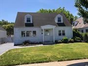 5 Bedroom, 2 Bath, Rear Dormered Cape with 2100 square feet of Living Space, Award Winning East Williston School District. Full Basement with Outside Entrance on a 50x100 property. Needs Updating - Priced To Sell!