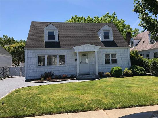 AWARD WINNING EAST WILLISTON SCHOOL DISTRICT PLENTY OF ROOM FOR MOM,  5 Bedroom, 2 Bath, Rear Dormered Cape with 2100 square feet of Living Space, . Full Basement with Outside Entrance on a 50x100 property. Needs Updating - Priced To Sell!
