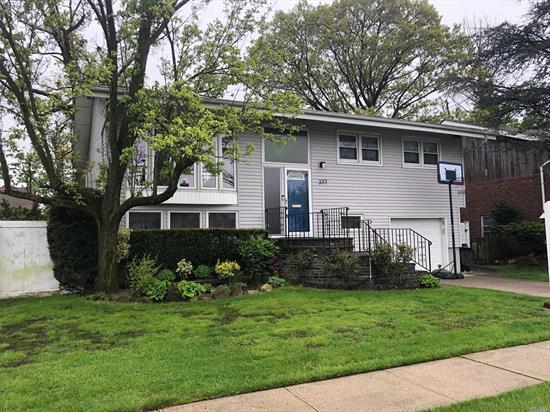 Beautifully Maintained 4BR Home. Features EIK W/Updated Appliances, Lg Deck Off Kitchen, Gas Heat, CAC, Alarm, IGS, HW Floors, New Roof, New Washer/Dryer, LR, DR With Vaulted Ceilings.