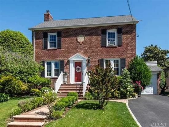 Beautiful Brick Center Hall Colonial. Large Formal Dining Room off the Kitchen. Formal Living Room with Renovated Wood Burning Fireplace. Kitchen with Marble Countertops, Pass Through Window to Large Den. Master Bedroom with Outdoor Access, Full Bath, Full Finished Basement, Laundry Area. Close to Train, Shopping, Restaurants.