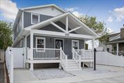 Designer Colonial Home Completely Renovated. Gorgeous Turn KeyFeatures 4 Bedrooms plus Master w/ En-suite. 3 Full Baths w/ European porcelain tile, Oak floors Throughout. E.I.K w/Carrara Quartz counter tops, Banquette w/storage, Central Air/Heating. Plenty of Storage Throughout. Located Near Beach, Parkways, JFK, Shops! Bay views from the front porch! Come Live By The Water! Photos Represent Virtual Staging