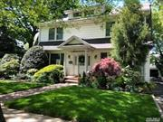 Lovely traditional center hall Dutch Colonial in the heart of SD20. Formal dining room, living room w wood-burning fp, & Four Seasons sunroom w gas fp. Close to LIRR, Lynbrook town, & more. New kitchen w SS, new AC, recently painted. Full finished basement, full-sized walk-up attic. Huge 2 car garage w walk-up 2nd floor for great storage. Sprinkler system using well water, central air & central alarm system. Park like yard (fully fenced) w enough room for a pool. Lovely new deck off the sunroom.