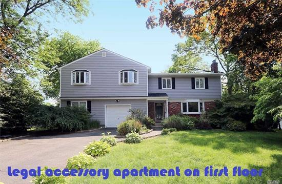 Wonderful opportunity to own this Colonial residence with a legal accessory apartment on the first floor. Mid block, residential location, new siding and new roof, large living spaces on both floors, located on pristine half acre property with upper and lower decks. Total living space approximately 3, 400 sq.ft. Commack Schools #10. Centrally located close to shopping, schools and transportation.