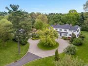 On a private Cul-De-Sac, Long tree-lined driveway leads to this incredible Gatsby estate on 3 Bucolic acres. Renovated in 2006. Tranquil oasis is a blending of Old World charm with today's amenities. Generous proportions, natural light and lush outdoor vistas. 970 s/f Master Suite includes 345 s/f closet space. Gourmet Kitchen/Breakfast room leads to family room, media room and pub w/full bar. Heated Gunite pool & spa in country club setting. Separate all-season pool house.