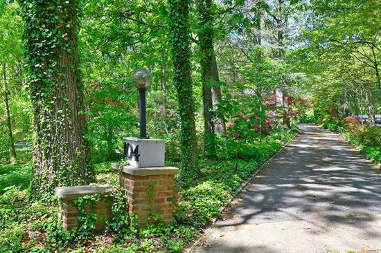 A beautiful private acre in desireable Half Hollow Hills SD. One of a Kind, Charming 3 Bed/2.5 Bath Dutch Colonial. The long treelined driveway leads to a unique covered breezeway/carport surrounded by hundreds of rhododendrons, maples, dogwoods and azaleas. Formal dining room with sliders out to expansive deck, galley kitchen, mbdrm w/bath, all bedrooms have private balconies. Full basement with laundry. CAC, IGS. Vanderbilt, Candlewood HHH West. Must see!