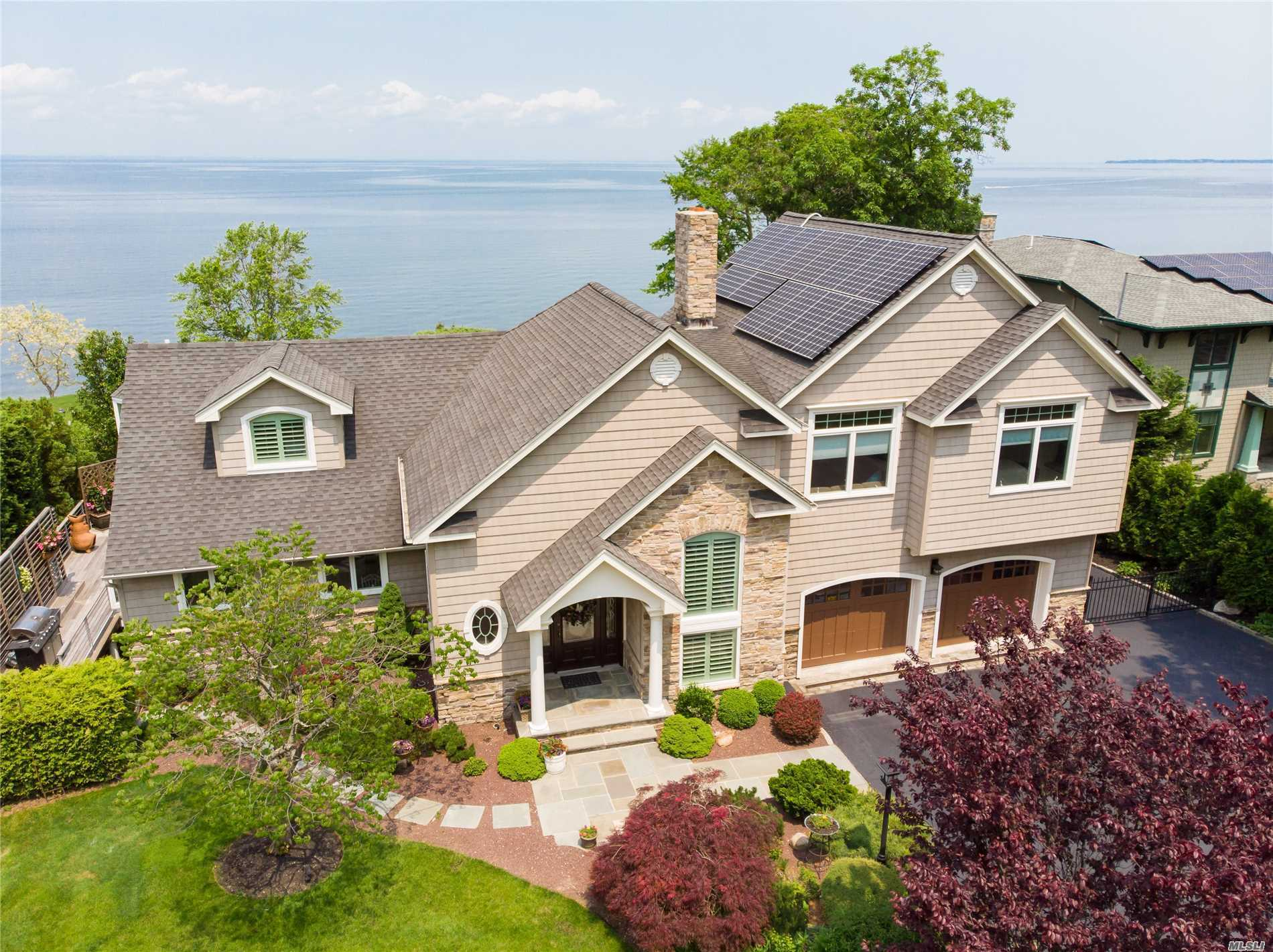 Post modern custom colonial with 3 levels of unobstructed view of the long Island sound.built with highest quality material and tasteful design to take advantage of the fabulous location, lush lawn, Ipe wood wraparound deck, back porch gazing at the water, complete privacy on both sides of the property created by tall specimen trees, stairs down to the sandy beach.. A two story foyer leads you to a great room/ open concept & view of the water from every corner.