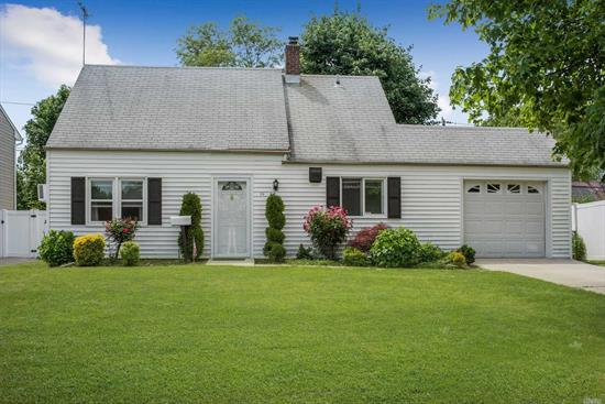 Mid Block Location in the Island Trees School District #26. Close to ALL : Schools, Shopping, Public Transportation. Highways. Levittown POOL down the block. Large Fenced in Backyard. Attached Garage.