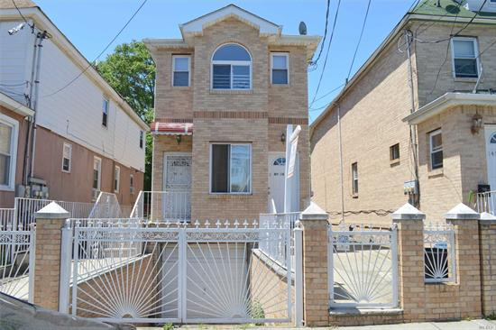 Excellent 2 family built in 2005. Nice hardwood floors throughout. Attached Garage with access to basement.  Backyard patio. 2 Separate Boilers and Hot Water Heaters, tenants pay their own utilities. Close to all including belt parkway, Q6-Q111-Q114 Bus lines and airport.