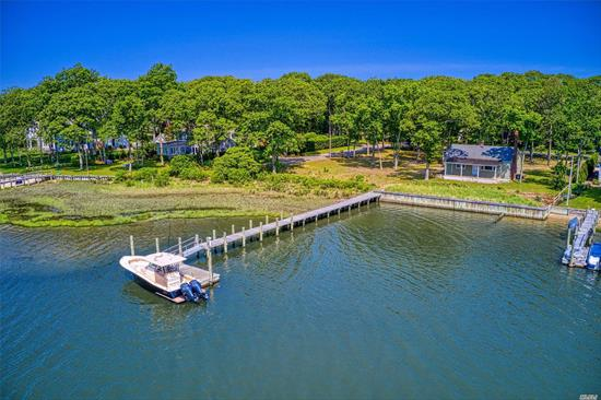 One of the last double lots on Broadwater's Cove. Big water view. Paradise awaits you in Cutchogue, NY's sunniest village at this pristine cottage w/160' waterfrontage. The bright & airy 2-bedroom home features a wood burning fireplace, ideal for cozy nights, as well as a bulkhead and new dock. The premier Broadwater's Cove Ass'n w/ boating access to the Peconic Bay & beyond is a coveted spot by Nassau Point causeway beach. Enjoy this season at the cottage while planning dream home.