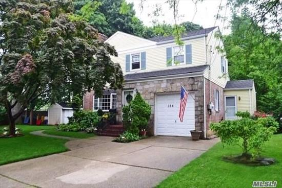 STATELY WESTWOOD COLONIAL LOCATED ON A PRIVATE DEAD END STREET. THIS HOME BOASTS OAK FLOORS, NEW CUSTOM BATHROOM, LARGE ROOMS THROUGHOUT, OAK FLOORS 1ST FLOOR LAUNDRY ROOM AND MANY UPDATES. NESTLED ON PARK-LIKE MANICURED GROUNDS. LOW TAXES AND WALKING DISTANCE TO THE WESTWOOD TRAIN STATION.