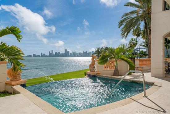 Exquisite Bayfront Villa On The Exclusive Fisher Island, America'S Wealthiest Zip Code. This Grand, 6-Bedroom/ 7.5 Bath Stunner Boasts 6, 618Sqft Of Luxury With An Impressive 2, 000Sqft Terrace Overlooking Biscayne Bay And The Miami Skyline. Custom Interiors By World-Renowned Designer Steven G. Enjoy The Majestic Miami Sunsets From The Expansive Lanai Featuring One Of The Islands Only Private Infinity Pools. Spacious Living Areas, Well-Appointed Guest Rooms, And A Stunning Master Suite With Attached Office, Huge Walk-In Closets, And Beautiful His-And-Hers Master Baths. Uniquely Designed Architecture With Marble Finishes Throughout. Truly One Of The Most Desirable Residences Available On Fisher Island.
