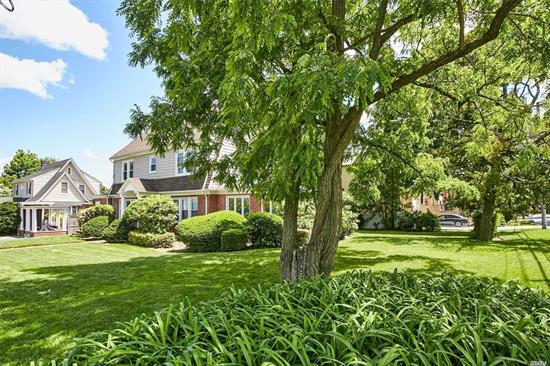 Beautifully maintained classic center hall colonial home located on over-sized lot in the heart of beautiful Bayside. 6 bedrooms, 3 full and 2 half baths. Updated eat-in-kitchen and baths, hardwood floors, classic architectural details, new windows, new boilers, laundry room. Convenient to shopping, restaurants and LIRR.