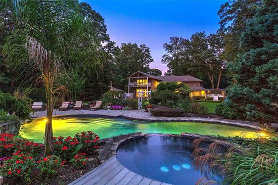 Resort style living in highly sought after section of Dix Hills. Home is redesigned and meticulously maintained. Grand entry, high ceiling, oversized rooms -perfect for entertaining, wood floors, oversized master with ensuite bath incl radiant floors. State of the art kitchen W/top of the line App, whole house overlooks the spectacular backyard w/ gunite heated pool/spa, New tennis ct w/ professional lighting, Gazebo w/kitchen and bars. 2 Pergolas w/2 BBQ's and fireplace
