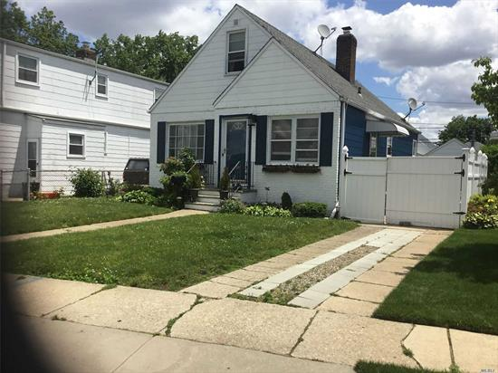4 bedrooms with 2 full bath and finished high ceiling basement with lots of storage closets