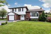 A three bedroom split with a large living room with cathedral ceiling, formal dining room, eat in kitchen featuring hardwood floors, 3/4 bedrooms, finished basement, bedroom can be on the first floor if you need it, attached garage, mid block, garage- a must see !!!!