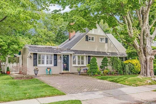 Move in Ready Expanded Levitt Cape, featuring large Living room, dining room, Gorgeous Eat in Kitchen, 4 bedrooms, 2 full baths, manicured landscaped private yard with pond & hot tub, master bedroom on 1st floor.