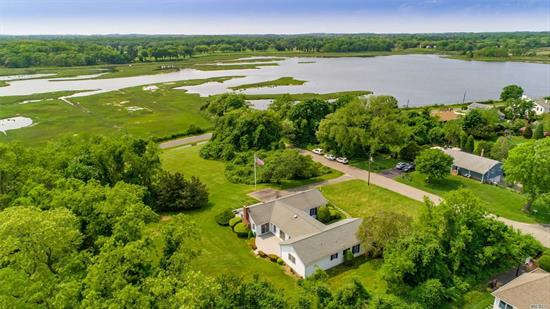 Outstanding Water Views in New Suffolk ~ Set high on 1.66 acres of gently rolling grounds, this lovely 3 bedroom, 2.5-bath expanded H-shaped ranch enjoys spectacular views of West Creek and glorious sunsets! Beautifully designed around the waterviews and the two large decks, this elegant house enjoys ease of entertaining both indoors and out. Near New Suffolk Beach and all that both the enchanting bayfront hamlet of New Suffolk and the stately historic hamlet of Cutchogue have to offer!