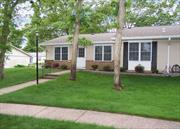 Sale may be subject to term & conditions of an offering plan. Completely redone. White Kitchen Cabinets with accent lighting, granite counters, tile backsplash, SS High-End appliances, waterproof vinyl wood plank floors, modern bathroom with double vanity, walk-in shower and dual flush water saver toilet, 12/x24 Calcutta Marble glazed porcelain shower walls. New windows, interior doors, 5 molding. Newer roof and gutters. There is only 1 additional unit attached to this house.