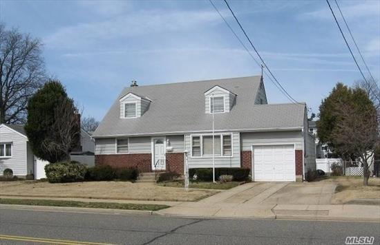 Center Hall Exp. Cape features full rear dormer, CAC, 5 Bedrooms, 2 Full Baths, finished Basement w/access to oversized garage, 200 amp electric, 2 zone heat, Peerless Boiler, deck off Kitchen, hardwood floors, electric garage door opener, Woodward Pkwy Elementary School, close to shopping & village, brick & alum. siding.