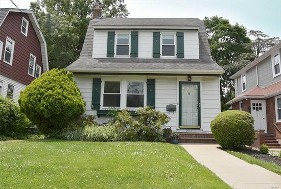 Great opportunity in beautiful Bell Court! Traditional two bedroom, one bath colonial on a quiet tree-lined street only blocks to the L.I.R.R., shops, restaurants, houses of worship. Oversized 40 x 100 property with private driveway. Prestigious school district #26 . PS 159/MS 158. Full basement with side entrance.
