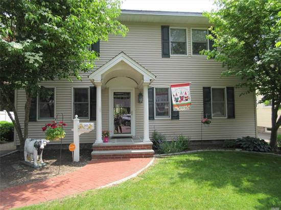 Babylon Village Colonial with Plenty of Room to Roam! Lovely Gourmet Kitchen with Pantry closet, Stone Countertops, and High End Appliances! Huge Dining Room, Living Rm w/Fireplace! Spacious Master Bedroom Suite with 2 WIC's, Sitting Rm, & Dressing Area! Generously Sized Family Room w/Window Seat and Storage! Lots of Closet Space, HW and Tile Floors, New Carpet, Solar Power! IGS. Lovely Park like Backyard