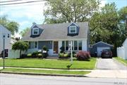 Great Rear Dormer Wide Line Cape North Of The Pike Set On A 60x101 Property, Features New Boiler, Windows, and Roof, Updated Eat In Kitchen, Full Bath , 200 amp Service, Fantastic Location
