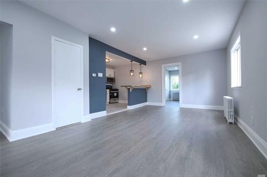 Turn key 2 Family Colonial Charmer, located in Valley Stream, Featuring 4 Bedrooms, 3 Bathrooms, NEW SS Kitchens, Trendy Butcher Block Counter(s), Islands, New Baths, Finished Basement, OSE, Long PVT w/ 2 Car Garage, Recessed Lighting Throughout & Engineered Hardwood Floors. Conveniently Located With Walking Distance To Merrick Rd Shopping, Valley Stream State Park. Steps Away From Southern State Parkway (exit-15) Within Less Than 5 Min. This Beautifully Done Home Will Not Last.