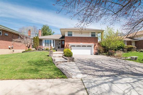 This Split Level Home in the coveted Westbury Hills Section of Westbury sits on 6000 sq ft. of updated outdoor living. Features includes 3 bedrooms, 2.5 baths, hardwood floors, updated Kitchen and Baths, skylight, solarium outdoor kitchen and other features too numerous to mention. Call for your private showing.
