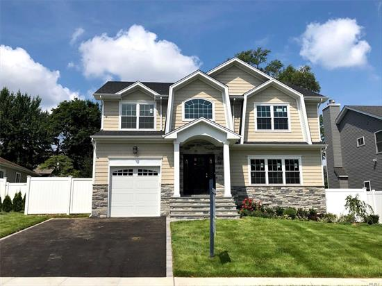 Still Time To Customize This Beautiful 5 Bedroom New Construction In Syosset, North of Jericho TPK With South Grove Elementary & South Woods Middle School! 9' Ft Ceiling On 1st Fl. 9'Ft Basement Ceiling w/Outside Entrance, **TWO Mastersuites**, One On 1st Fl. Custom Kitchen Opens To A Beautiful Great Room. This House Boasts One Of The **DEEPEST backyards**, ! Pictures Represent Past Constructions By The Builder To Show Quality Of Finishes & Work. *****A Must See*****