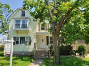 VINTAGE COLONIAL,  SPACIOUS, BRIGHT,  WATER VIEW,  10 ROOMS (2 BATH ROOMS) DETACHED GARAGE. MINUTES FROM BEACH, RAILROAD AND DOWNTOWN OYSTER BAY. SOLD AS IS. POSSIBLE MOTHER/DAUGHTER WITH PROPER PERMIT.
