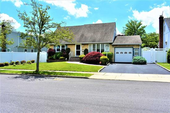 Move Right In To This Beautiful 4 Bedroom, 2 Bath Expanded Cape With Full Basement. This Home Features Hardwood Floors, Updated Kitchen And Bath, Eat In Kitchen, Living Room, Dinning Room, Bonus Room/Den, Gas Cooking and Heat, Central Air Conditioning, In-Ground Sprinklers, And Much More! This Home Wont Last!!