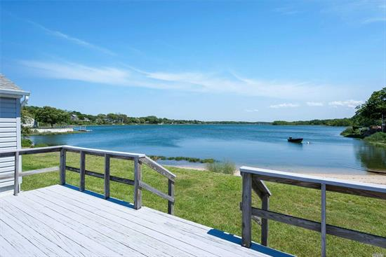 Water front ranch with forever views and 105 feet of private sandy beach on Hashamomuck. The North Fork Dream: Paddle, Sail, Fish, Clam, swim right from your back yard from Sunrise to Sunset. Southold Town beach on long Island Sound is directly across the road.
