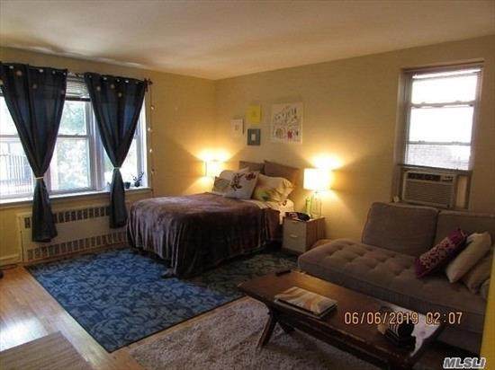 Forest Hills - Large Studio for Rent in Coop Building only 1 Block to Queens Blvd. Great location only 1 block to M + R Trains. 10 Mins walk to E+F+LIRR trains. This spacious and bright studio offers HW Floors, Reno Kitchen, Separate Dressing Area, Full Bathroom. Modern laundry facilities on lobby level. Street Parking or W/L for garage. Board approval required.