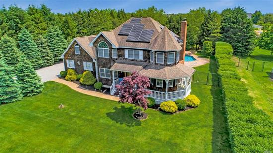 Location! Location! Location! 3 Houses From the Community Bay Beach on 0.83 Acres. Inground Heated Gunite Pool with Waterfall Feature. So Close to Beach That You Can Hear The Waves Crash on The Shore From Your Porch or Pool Side Patio. Nicely Updated. 3 Bedroom/3 Bath. Living Room with Wood Burning Fireplace. Family Room with Gas Fireplace. Hardwood Floors and Such a Nice Layout!