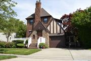 Beautiful All Brick Tudor In The Yorshire Section Of Lynbrook. House Boasts Kitchen W/ Open Island And Granite Counter Tops, Den, Hardwood Floors Throughout, 2 Wood Burning Fireplaces, Master Bedroom With Private Terrace, Front Porch, Rear Deck, And Much More...