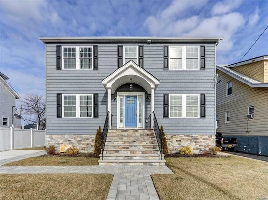 NEW CONSTRUCTION!. Spectacular 2500 sqft 4 Bedroom, Center Hall Colonial. Water views, Energy Star FEMA Complaint, Georgios Oak Floors, Pella Windows, Gas Heat , CAC, GENERAX Generator Ready, Central Vacuum, All LED Lighting inside & Out, Formal D- Room, Formal L-Room, Great Room w/Gas Fireplace, Open Floor Plan Kitchen w/huge Center Island. Master BR w/ Water Vviews, Mst Bath , 3 Large Bedrooms, 2 Full Baths, Laundry. Full Attic. Outdoor Deck, Fully Landscaped, Fenced, Un-Obstructed Water Views of Rockaways