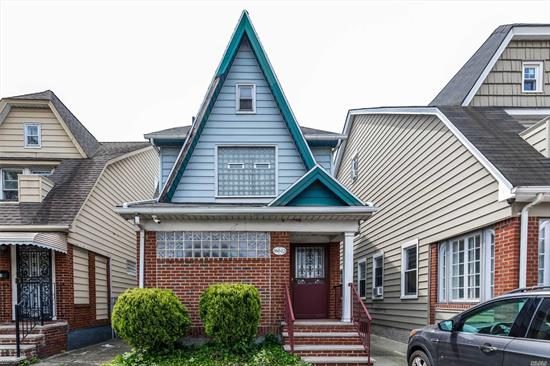 Spacious 1 family detached home in Jamaica Hills featuring private driveway with garage, private yard, modern bath, updated heating system. Convenient to shopping and transportation. Possible conversion to 2 family - check architect.