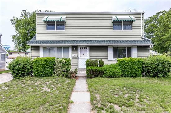 Lovely Mid Block Property On Over-Sized Beautiful Lot. Great Layout. Kitchen Needs Updating.