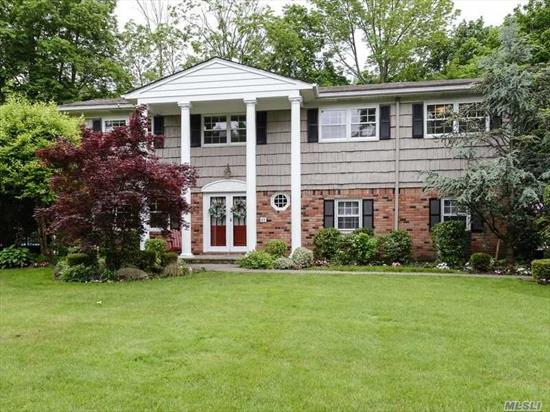 Sparkling Plandome Manor Spacious Residence w/Beach Rights. Cathedral Ceiling LR, FDR, Family Room w/fpl off Updated Granite EIK, Master Bedroom w/fpl, Master Bath, 4 Addtl. Bedrooms & Bath. Glorious Oversized Flat Property + Deeded Parking at Plandome LIRR Station.