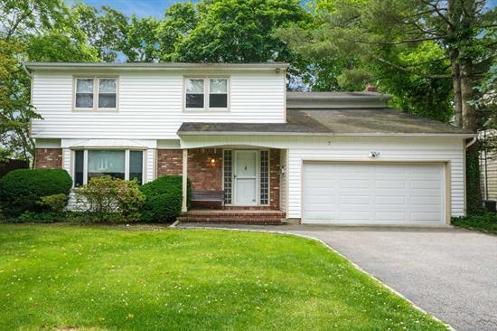 North Syosset young 2380 sq ft home located in a cul-de-sac with an easy distance to train & town. Large entertaining rooms, slider from kitchen leads to large private deck! Cozy Den with fireplace, master suite, 6 year young roof, generator, CAC, IGS Gas heat & cooking!! Truly a gem!!