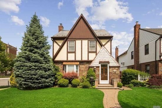 All information provided is deemed reliable, but is not guaranteed and should be independently verified. Welcome home to this brick detached 1 family tudor in Bellerose. This corner property features an enclosed glass sun room off the private yard perfect for realxing on a lazy Sunday afternoon. The formal dining room, large livingroom, eat-in-kitchen , 3 berooms and a full finished basement compliments the home. There is a private detached garage and private driveway