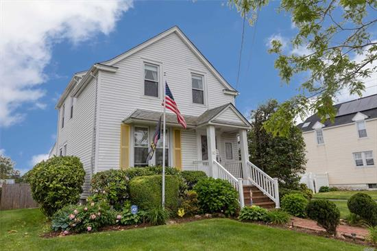 Beautiful large Colonial built in 1919 w/all the charm of yesteryear, updated EIK w/granite & stainless steel appliances, lg LR & Banquet FDR w/refinished hardwood floors, crown moldings & high ceilings, rear ext. Den w/vaulted ceiling, glass door knobs, all windows replaced, new gas heating system, o/s long driveway, 2 car det. garage, IGS, brick patio, Woodward Parkway Elementary.