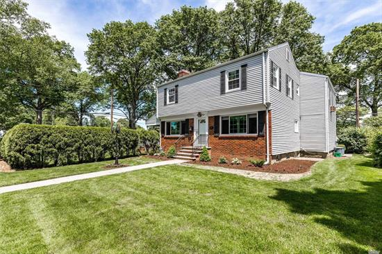 Garden City Rare Find-Mint++ Ctr Hall Colonial on Oversized Corner Lot on .20 of an acre w/Parking for 5 Cars. This magnificent home is ideally located just a few blocks from the LIRR for quick 30 min commute to NYC. Updated Kitchen w/Stainless Appliances & Granite. Formal DR and LR w/Fireplace and 2 New Anderson Windows. XL Master Suite w/Separate Dressing Room/Office and Full Bath, 3 Bright and Airy Lg Bedrooms and Full Bath. Gorgeous New Stone Patio for Entertaining-An Absolute Must See