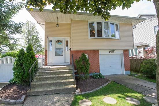 Location is Everything with this Picture Perfect Hi Ranch Home in the Heart of Bellmore! Immaculate with Great Lay-out! Updated to New Kitchen and Baths! Approx. 9 Year Old Roof, Siding, Windows, Cast Iron Boiler and Oil Tank! SOLD-AS-IS! Possible Mother/Daughter with Proper Permits!