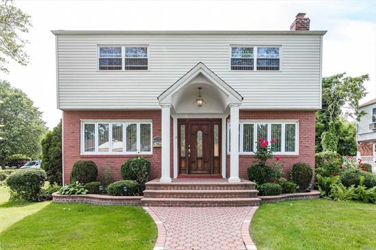 Corner Property- 1 Family Colonial (CH), 4 Large Bedrooms, 2.5 Baths, Den With Fireplace.32 Ft Master Bedroom Suite With Private bath, Lots Of Closets, In Ground Sprinklers, Curb Appeal Great Indoor & Out. Custom Made Drapes In Lr, Dr & Den With Many More Features. Its A Must See.