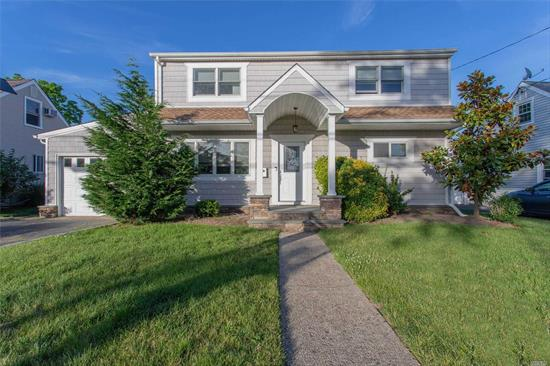 Come see this mint, 4 BR, 2.5 Bath Colonial home. All Updated, wood floors throughout, CAC, Contemporary Style Home. Great deck for entertaining in the backyard. Move right in.